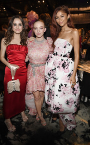 Sydney Sweeney teamed silver evening sandals with a pink high-low dress for the HBO post-Emmy reception.