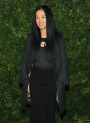 Vera Wang epitomized elegance in this charcoal evening coat she draped over her shoulders.