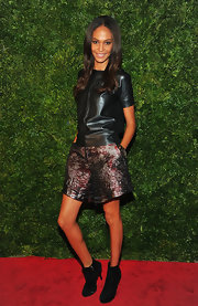 Joan Smalls wore a funky ensemble consisting of this black leather tee and brocade shorts.