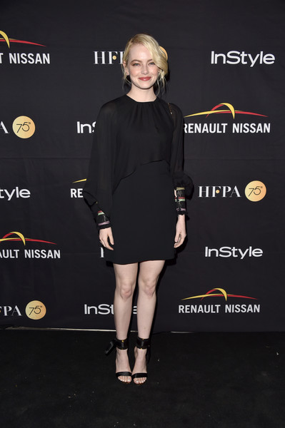 Emma Stone matched her dress with a pair of black satin ankle-cuff heels by Gianvito Rossi.