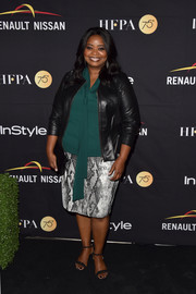 Octavia Spencer paired a gray snakeskin-print pencil skirt with a green tie-neck blouse for the HFPA and InStyle TIFF celebration.