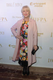 Helen Mirren donned a colorful floral frock for the HFPA and Participant Media event during the Cannes Film Festival.