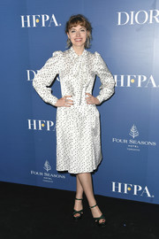 Imogen Poots opted for a demure look with this white tie-neck polka-dot dress at the HFPA/THR TIFF party.