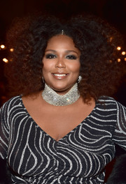 Lizzo attended the Spotify Secret Genius Awards wearing her hair in an afro.