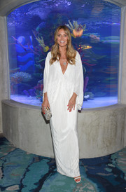 Heidi Klum looked diva-glam in a plunging white caftan by Sally LaPointe while attending a dinner at Ocean Resort Casino.