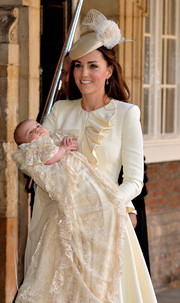 Kate Middleton chose a ruffled ivory Alexander McQueen jacket and and skirt duo for the christening of Prince George.
