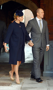 Zara Phillips attended the christening of Prince George wearing a navy coat and nude platform pumps.