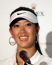 A pair of diamond hoops added a dose of glam to Michelle Wie's sporty look during the HSBC Women's Champions.