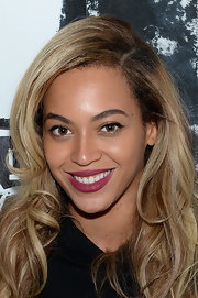 Beyonce's rich berry lips added a touch of color to Queen B's supple pout.