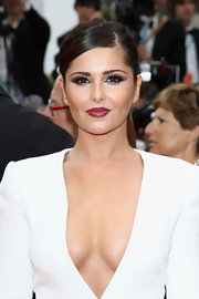 Cheryl Cole brought some drama to the red carpet with a burgundy pout. Smoldering eyeshadow completed her alluring look.