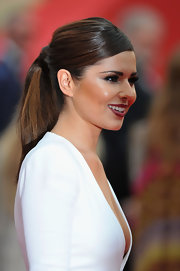 Cheryl Cole added a sleek touch to her look with a ponytail that was pinned at the center.