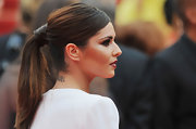 Cheryl pulled her hair up in a sleek ponytail and showed off her small neck tattoo.