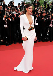 Cheryl went avante-gard for the Cannes Film Festival in a white evening gown with large gold pears.