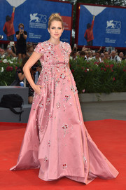 Teresa Palmer dolled up her baby bump in a custom Prada gown, boasting the label's signature jewel detailing, for the Venice Film Fest premiere of 'Hacksaw Ridge.'