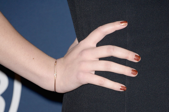 Hailee Steinfeld Gold Bracelet [finger,nail,hand,skin,arm,joint,gesture,wrist,thumb,material property,hailee steinfeld,post-party - arrivals,detail,beverly hills,california,instyle,warner bros. 71st annual golden globe awards,warner bros. 71st annual golden globe awards post-party]