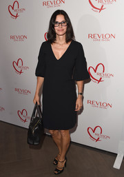 Courteney Cox complemented her dress with a pair of strappy black peep-toes.