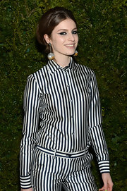 Tali Lennox gave a nod to mod in a black-and-white striped button-down shirt at an event in New York.