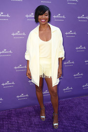Gabrielle Union styled her look with silver ankle-strap heels.