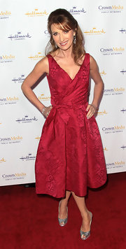 Jane Seymour accessorized her red cocktail dress with silver glittering slingbacks.