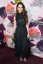 Jessica Lowndes looked darling in a black and gold polka-dot dress with a cinched-in waist and ruffle accents at the Hallmark Channel Winter TCA Press Tour.