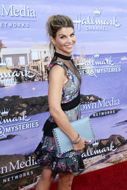 Lori Loughlin arrived for the Hallmark Channel Summer TCA Press Tour carrying a stylish studded clutch.