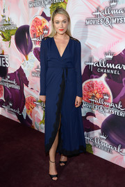 Katrina Bowden chose a chic navy wrap dress with black lace trim for the Hallmark Channel Winter TCA Press Tour.