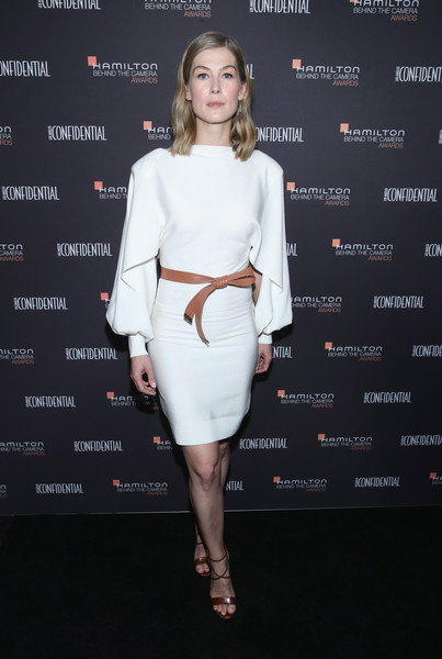 Rosamund Pike finished off her outfit with strappy brown heels.
