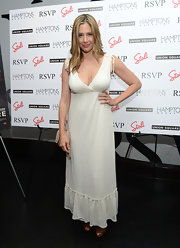 Mira Sorvino rocked a boho vibe at the Hamptons Magazine celebration in her white lace maxi dress.