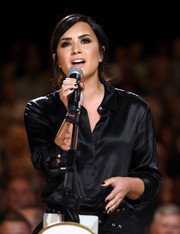 Demi Lovato went for casual elegance in a black silk button-down at the Hand in Hand benefit.