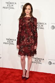 Alexis Bledel cut a sophisticated figure wearing this long-sleeve J. Mendel lace dress in two dark shades of red during the Tribeca Film Fest premiere of 'The Handmaid's Tale.'