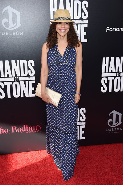 Rosie Perez attended the premiere of 'Hands of Stone' wearing a summery blue maxi dress.