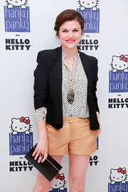 Tiffani Thiessen completed her smart ensemble with a black leather clutch at the Hanky Panky for Hello Kitty launch.