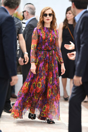 Isabelle Huppert brought a vibrant burst of color to the 'Happy End' photocall at the Cannes Film Festival with this floral maxi dress by Gucci.