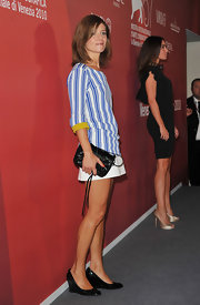 Marina looks so retro in this darling mini day dress with blue stripes and yellow cuffs.
