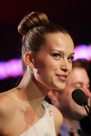 Supermodel Petra Nemcova showed off a sleek bun while hitting the Happy Hearts Fund in Thailand.