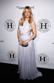 Kate Hudson went for trendy glamour in a lilac cutout gown by Roberto Cavalli during the Harmonist cocktail party.