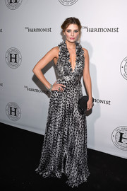 Mischa Barton made a chic appearance at the Harmonist cocktail party wearing a deep-V silver and black leopard-print gown.