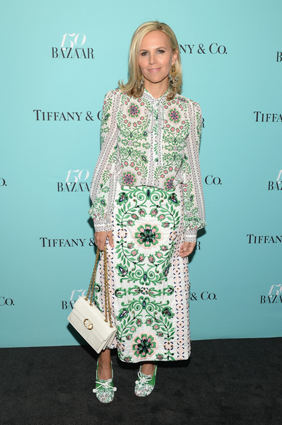 Tory Burch punctuated her prints with a solid white chain-strap bag.