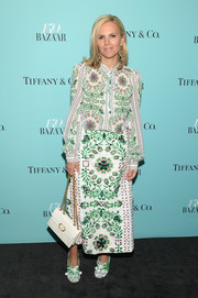 Tory Burch looked exuberant in a colorful print blouse from her own line at the Harper's Bazaar 150th anniversary party.