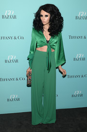 Stacey Bendet channeled the '70s with this green tie-front crop-top at the Harper's Bazaar 150th anniversary party.