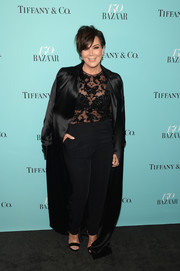 Kris Jenner draped a floor-length black satin coat over her shoulders for a more glamorous finish.