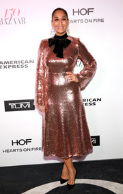 Tracee Ellis Ross was impossible to miss in a shimmering rose-gold sequin dress by Rasario at the Harper's Bazaar 150 Most Fashionable Women celebration.