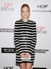 Portia Doubleday accessorized with a chic pearlized box clutch at the Harper's Bazaar 150 Most Fashionable Women celebration.