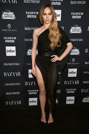 Suki Waterhouse looked ravishing in a high-slit, Swarovski crystal-embellished one-shoulder dress by Alexandre Vauthier Couture at the Harper's Bazaar Icons event.