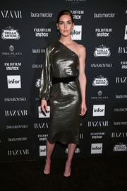 Hilary Rhoda cut a sophisticated figure in a one-sleeve gold lame dress by Markarian at the Harper's Bazaar Icons event.
