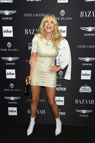 Christie Brinkley topped off her dress with a white denim jacket.