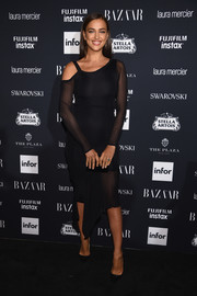 Irina Shayk went modern in an asymmetrical LBD with sheer sleeves at the Harper's Bazaar Icons event.