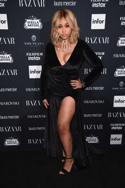 Jordyn Woods complemented her dress with black patent sandals.