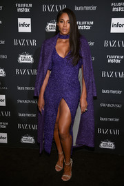Ciara flashed some leg and cleavage in this purple Rasario dress at the Harper's Bazaar Icons event.