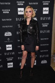 Peyton List went for a tough vibe with this studded black leather jacket at the Harper's Bazaar Icons event.